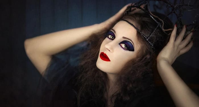 Sexy glamorous witch dark eyes and red lips