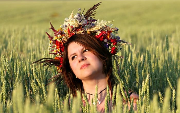 Wiccan girl in a corn field - nature oriented religions