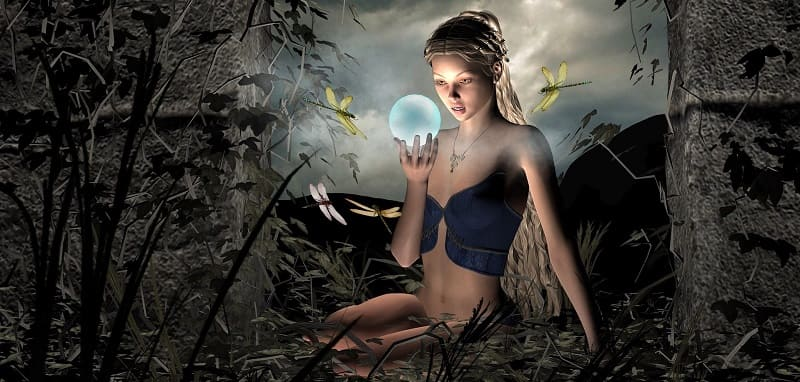 Sexy pagan woman with crystal ball